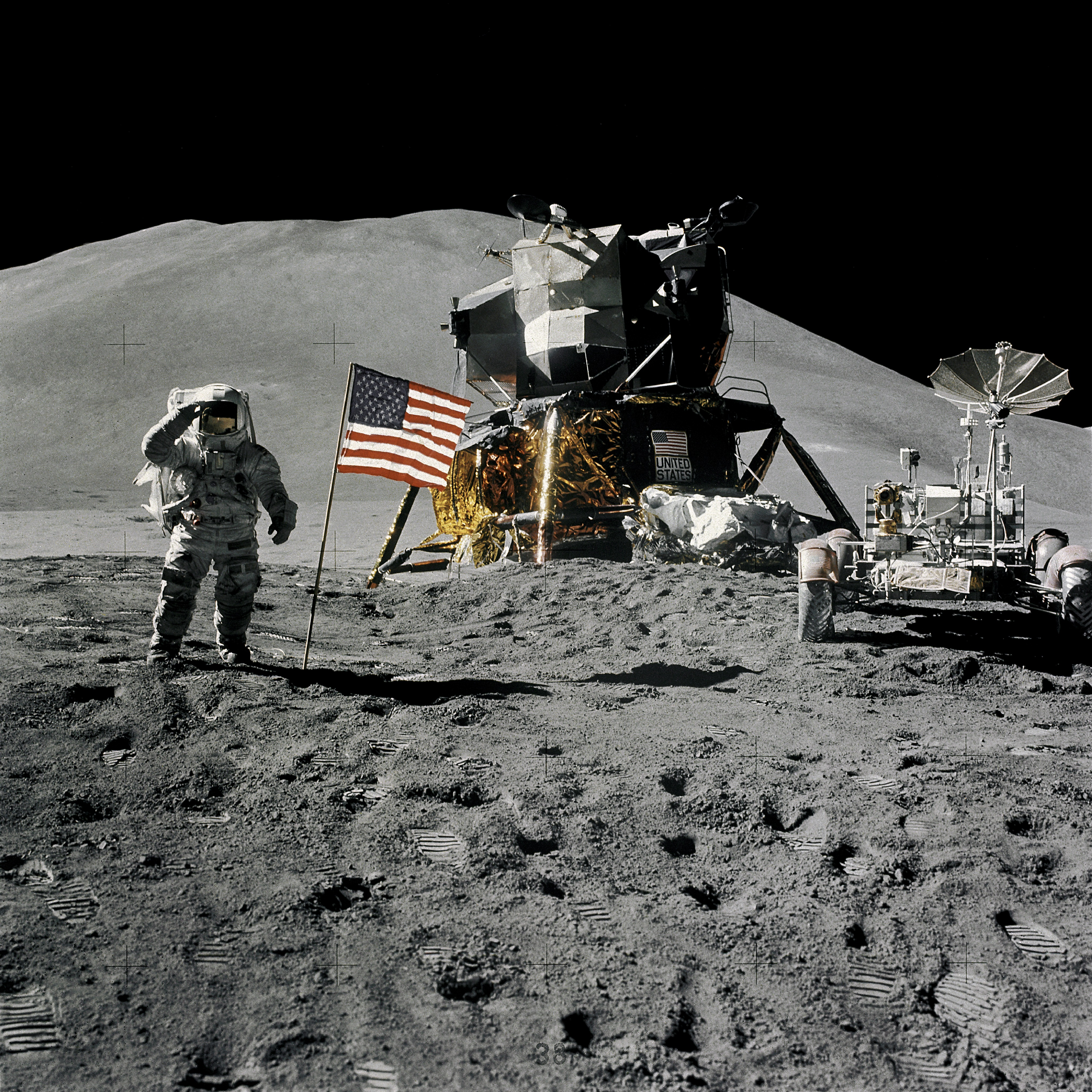 Astronaut James B. Irwin, lunar module pilot, gives a military salute while standing beside the deployed United States flag during the Apollo 15